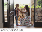 Купить «Mother preparing her daughter for school», фото № 30942198, снято 12 марта 2019 г. (c) Wavebreak Media / Фотобанк Лори