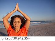 Купить «Beautiful woman doing yoga on beach in the sunshine», фото № 30942354, снято 15 марта 2019 г. (c) Wavebreak Media / Фотобанк Лори
