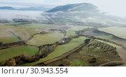 Купить «Aerial landscape of Navarre valleys and hills, North Spain», видеоролик № 30943554, снято 26 декабря 2018 г. (c) Яков Филимонов / Фотобанк Лори