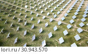 Купить «Aerial view of solar power station installed in green field», видеоролик № 30943570, снято 19 декабря 2018 г. (c) Яков Филимонов / Фотобанк Лори