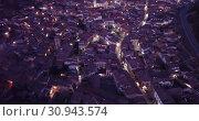 Купить «Evening aerial view of medieval Spanish town of Daroca with illuminated Basilica of St. Mary of Sacred Body», видеоролик № 30943574, снято 9 марта 2019 г. (c) Яков Филимонов / Фотобанк Лори
