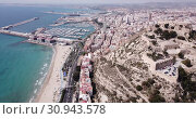 Купить «Aerial view of holiday sand beach and city Alicante, Spain», видеоролик № 30943578, снято 17 апреля 2019 г. (c) Яков Филимонов / Фотобанк Лори