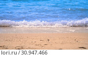 Clear light blue color sea water or liquid marine waving and splashing to light brown color sand beach on summer day in Pattaya Thailand and no people swimming because of hot weather. Стоковое фото, фотограф YAY Micro / easy Fotostock / Фотобанк Лори