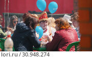 Купить «Tatarstan, Laishevo 25-05-2019: Women in traditional Russian costumes are sitting at the tables eating food.», видеоролик № 30948274, снято 22 июля 2019 г. (c) Константин Шишкин / Фотобанк Лори