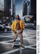 Купить «Black rapper on street, cityscape on background», фото № 30948950, снято 5 апреля 2019 г. (c) Tryapitsyn Sergiy / Фотобанк Лори