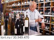 Купить «Winemaker checking wine in store», фото № 30949470, снято 8 мая 2019 г. (c) Яков Филимонов / Фотобанк Лори