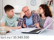 Купить «Family soothing chagrined man», фото № 30949590, снято 23 мая 2019 г. (c) Яков Филимонов / Фотобанк Лори