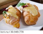 Купить «Croissant with Camembert and pine nuts», фото № 30949778, снято 23 июля 2019 г. (c) Яков Филимонов / Фотобанк Лори