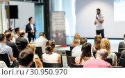 Купить «Male business speaker giving a talk at business conference event.», фото № 30950970, снято 15 июня 2018 г. (c) Matej Kastelic / Фотобанк Лори