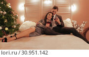 Married couple are celebrating their anniversary at New Year in romantic atmosphere slow motion. Стоковое видео, видеограф Denis Mishchenko / Фотобанк Лори
