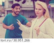 Купить «Husband and wife are emotional quarreling», фото № 30951266, снято 10 августа 2017 г. (c) Яков Филимонов / Фотобанк Лори