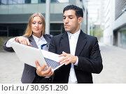 Купить «Couple professionals are examinating project on laptop», фото № 30951290, снято 20 августа 2017 г. (c) Яков Филимонов / Фотобанк Лори