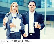 Купить «Portrait of couple who are standing with folder and coffee», фото № 30951294, снято 20 августа 2017 г. (c) Яков Филимонов / Фотобанк Лори
