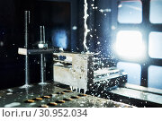Купить «Electrical discharge machine. Precision metal processing by spark wire eroding», фото № 30952034, снято 28 мая 2019 г. (c) Дмитрий Калиновский / Фотобанк Лори