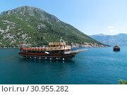 Купить «Perast, Montenegro - June 10. 2019. Beautiful excursion boat in a Boka-Kotorska bay», фото № 30955282, снято 10 июня 2019 г. (c) Володина Ольга / Фотобанк Лори