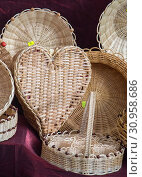 Купить «Empty wicker baskets are for sale in a market», фото № 30958686, снято 20 сентября 2017 г. (c) easy Fotostock / Фотобанк Лори