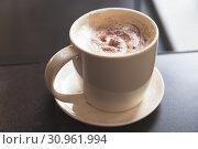 Купить «Cappuccino. Mug of coffee with milk foam», фото № 30961994, снято 9 апреля 2019 г. (c) EugeneSergeev / Фотобанк Лори