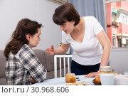 Купить «Portrait of upset young women discussing, quarrel during drinking tea at home kitchen», фото № 30968606, снято 19 июня 2019 г. (c) Яков Филимонов / Фотобанк Лори