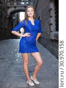 Купить «Young woman is posing in blue dress», фото № 30970158, снято 30 июля 2017 г. (c) Яков Филимонов / Фотобанк Лори