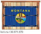 Купить «A large closed wooden barn double door with bolt and hinges and the Montana state flag painted on», фото № 30971970, снято 30 декабря 2018 г. (c) easy Fotostock / Фотобанк Лори