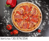 Купить «Pizza with sausage, tomatoes and cheese on a plate», фото № 30974554, снято 6 апреля 2019 г. (c) Алексей Кокорин / Фотобанк Лори