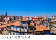 Купить «View over the rooftops of the city from the Cathedral, looking towards the Clerigos Tower, Porto, Portugal», фото № 30975454, снято 17 июля 2018 г. (c) Николай Коржов / Фотобанк Лори