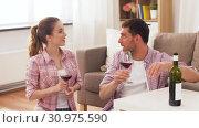 Купить «happy couple drinking red wine at home», видеоролик № 30975590, снято 10 июня 2019 г. (c) Syda Productions / Фотобанк Лори