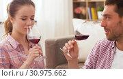 Купить «happy couple drinking red wine at home», видеоролик № 30975662, снято 10 июня 2019 г. (c) Syda Productions / Фотобанк Лори