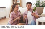 Купить «happy couple drinking red wine at home», видеоролик № 30975758, снято 10 июня 2019 г. (c) Syda Productions / Фотобанк Лори