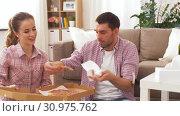 Купить «couple eating takeaway pizza at home», видеоролик № 30975762, снято 10 июня 2019 г. (c) Syda Productions / Фотобанк Лори