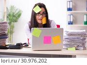 Купить «Young female employee in conflicting priorities concept», фото № 30976202, снято 15 января 2019 г. (c) Elnur / Фотобанк Лори