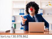 Купить «Young clown businessman working in the office», фото № 30978862, снято 14 декабря 2018 г. (c) Elnur / Фотобанк Лори