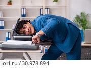 Купить «Young employee making copies at copying machine», фото № 30978894, снято 14 декабря 2018 г. (c) Elnur / Фотобанк Лори