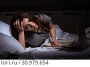 Купить «Tired businesswoman working overtime at home at night», фото № 30979654, снято 5 февраля 2019 г. (c) Elnur / Фотобанк Лори