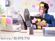 Купить «Young male handsome employee in conflicting priorities concept», фото № 30979710, снято 7 января 2019 г. (c) Elnur / Фотобанк Лори