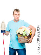 Купить «Portrait of a man with an iron and a basket of clean linen on a white background», фото № 30982034, снято 25 ноября 2017 г. (c) easy Fotostock / Фотобанк Лори