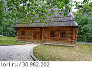 Купить «Old ukrtic Ukrinsky house with a wooden roof on the background of the green park zone», фото № 30982202, снято 1 августа 2013 г. (c) easy Fotostock / Фотобанк Лори