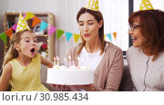 Купить «mother, daughter, grandmother with birthday cake», видеоролик № 30985434, снято 14 июня 2019 г. (c) Syda Productions / Фотобанк Лори