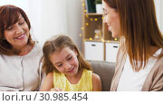 Купить «mother, daughter and grandmother doing make up», видеоролик № 30985454, снято 14 июня 2019 г. (c) Syda Productions / Фотобанк Лори