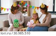 Купить «family greeting girl with birthday at home party», видеоролик № 30985510, снято 14 июня 2019 г. (c) Syda Productions / Фотобанк Лори
