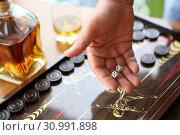 Купить «Мужская рука бросающая кубики. Нарды», фото № 30991898, снято 16 июня 2019 г. (c) Марина Володько / Фотобанк Лори