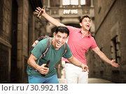 Two male fans are drinking beer after football match. Стоковое фото, фотограф Яков Филимонов / Фотобанк Лори
