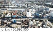Купить «Top view of the chemical plant and the surrounding area», видеоролик № 30993950, снято 5 марта 2019 г. (c) Яков Филимонов / Фотобанк Лори