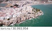 Купить «Aerial view of ancient fortress in Peniscola, Spain», видеоролик № 30993954, снято 16 апреля 2019 г. (c) Яков Филимонов / Фотобанк Лори