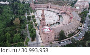 Купить «Aerial view of Plaza d'Espana with park and a bridge on ver the canal in Sevilla», видеоролик № 30993958, снято 19 апреля 2019 г. (c) Яков Филимонов / Фотобанк Лори
