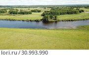 Купить «Panoramic view of gulf meadows in the floodplain of the Oka River, Russia», видеоролик № 30993990, снято 27 июня 2018 г. (c) Яков Филимонов / Фотобанк Лори