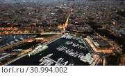 Купить «View from drones of sailboats and yachts in old port of Barcelona and gothic quarter at night», видеоролик № 30994002, снято 28 сентября 2018 г. (c) Яков Филимонов / Фотобанк Лори