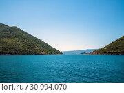 Купить «Summertime landscape in Kotor bay in Montenegro», фото № 30994070, снято 10 июня 2019 г. (c) Володина Ольга / Фотобанк Лори