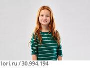 Купить «smiling red haired girl in striped shirt», фото № 30994194, снято 9 марта 2019 г. (c) Syda Productions / Фотобанк Лори