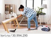 Купить «woman or housewife with vacuum cleaner at home», фото № 30994290, снято 7 апреля 2019 г. (c) Syda Productions / Фотобанк Лори